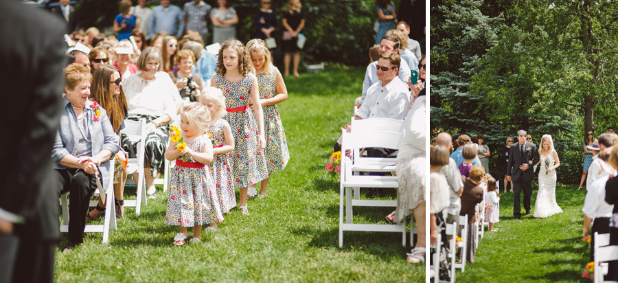 flower girls walk down the aisle followed by a gorgeous bride in boulder colorado