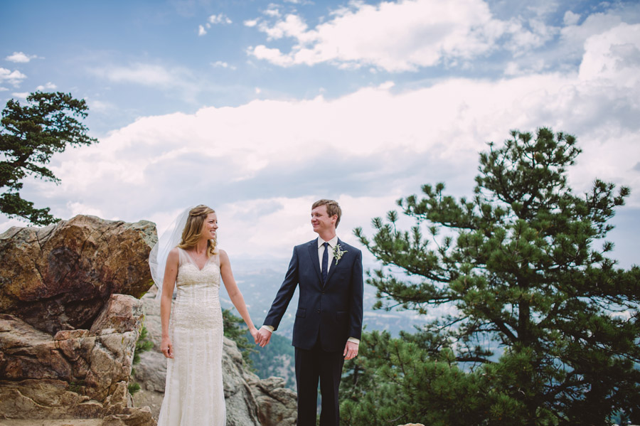 bride and groom smile at each other at scenic overlook in boulder foothills