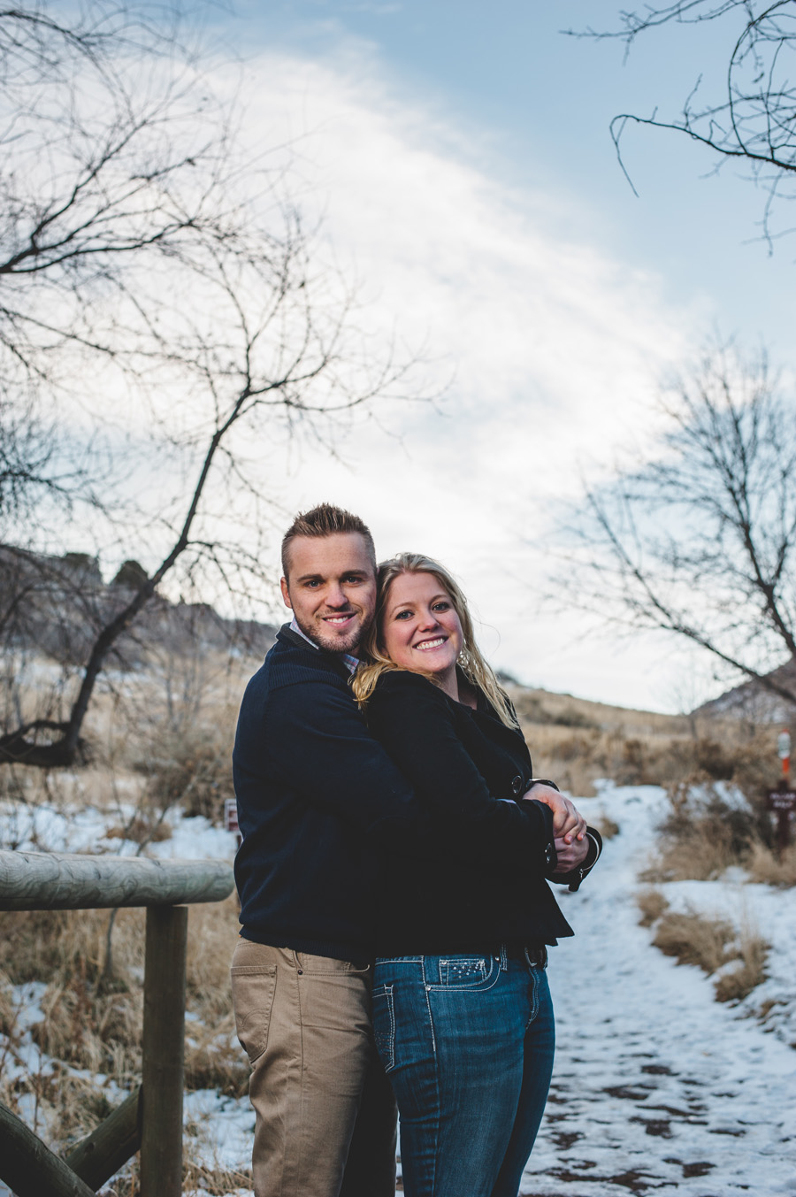 engagement photo on wooden bridge in mathews/winters park in colorado