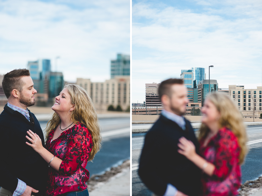 couple posing for engagement photos in front of DTC skyline