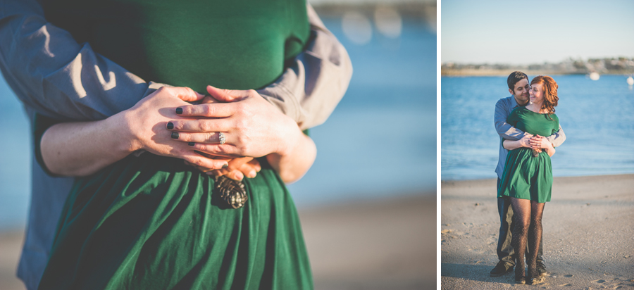 engaged couple embraces in front of mission bay, creative wedding photography