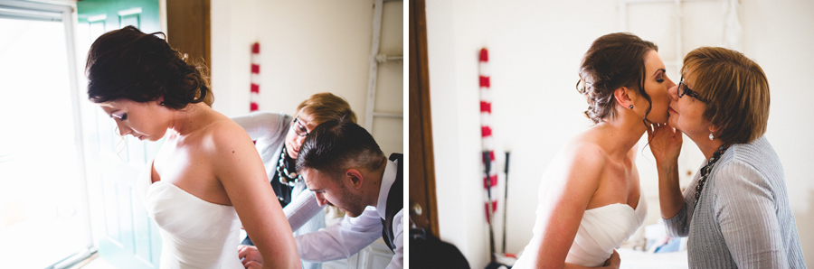 Mother and brother help bride get into wedding dress