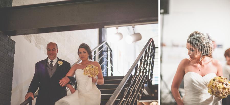 bride makes entrance to space gallery wedding
