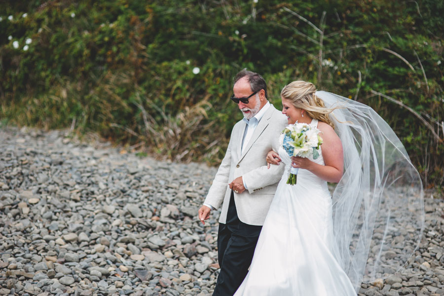 bride and father make wedding entrance oregon coast