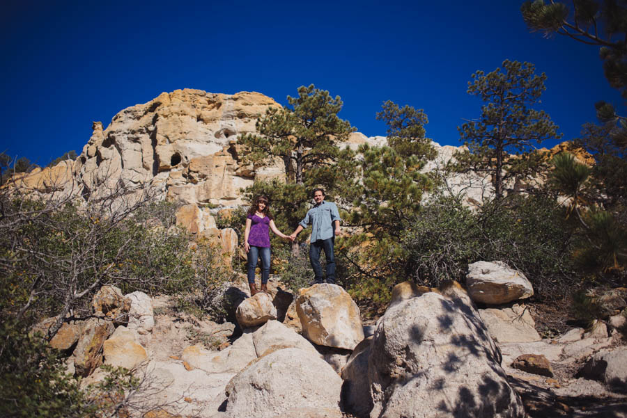 couple posing on boulders in Palmer park, Colorado Springs by Denver Wedding Photographer Dan Hand