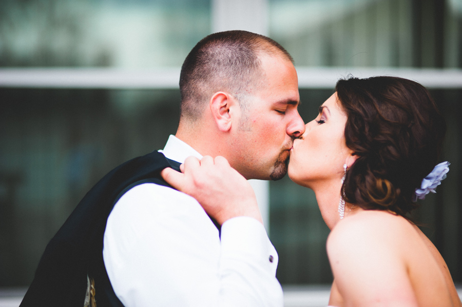lovely bride and groom kiss before wedding