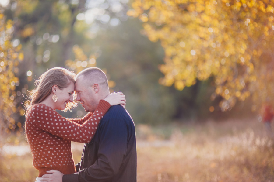 couple posing for engagement photos in Denver, Colorado during the fall