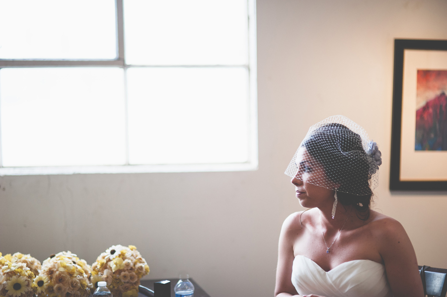 bride waiting in front of giant window in the Space Gallery, Denver