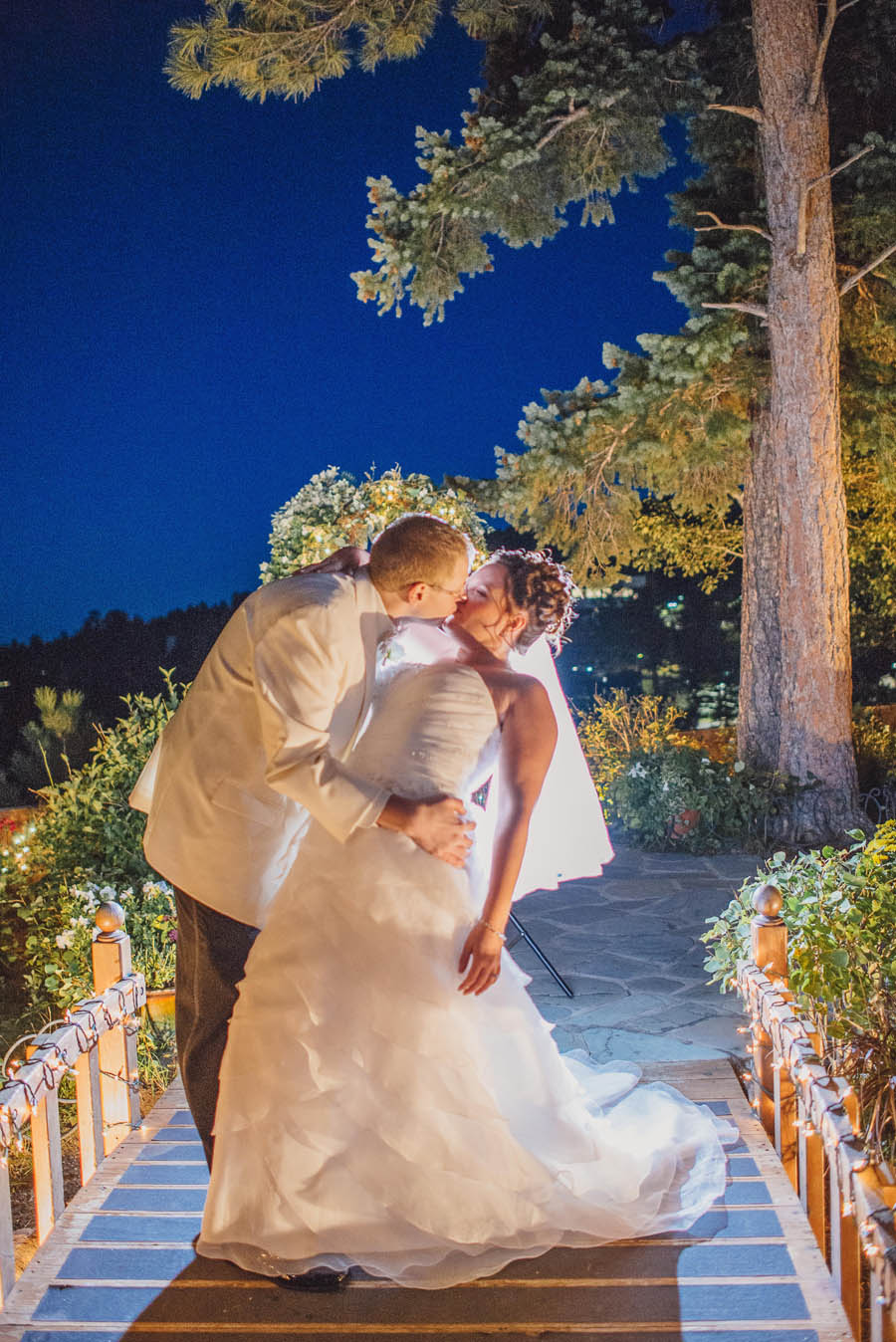 bride and groom kiss in colorado foothills