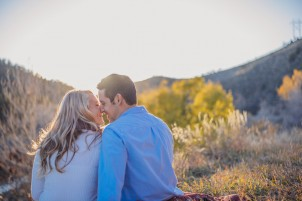 Engaged couple kiss during the sunset in the colorado foothills