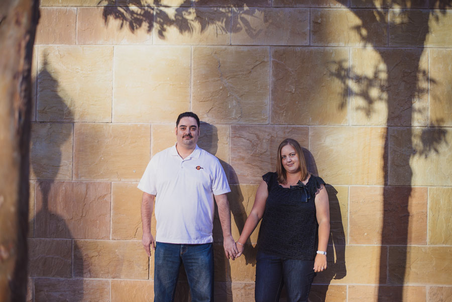 Engagement photo between cool shadows in downtown san diego