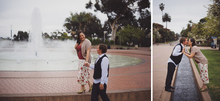 playful engagement photos near the fountain at balboa park