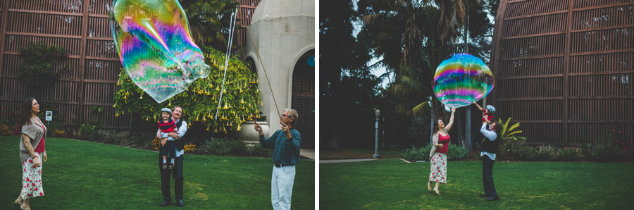 family pops gigantic bubble in balboa park