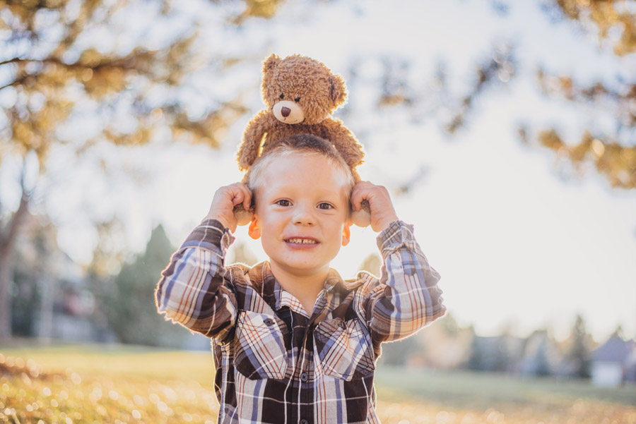 Cute kid poses for family portrait in Denver Colorado