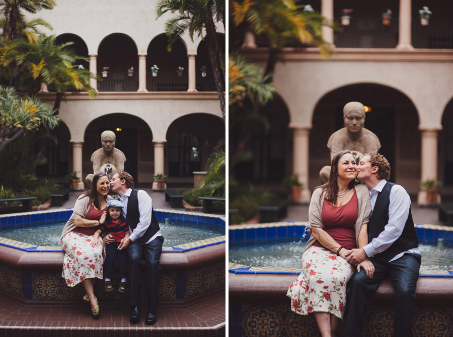 couple relaxing together on small fountain in the prado, balboa park