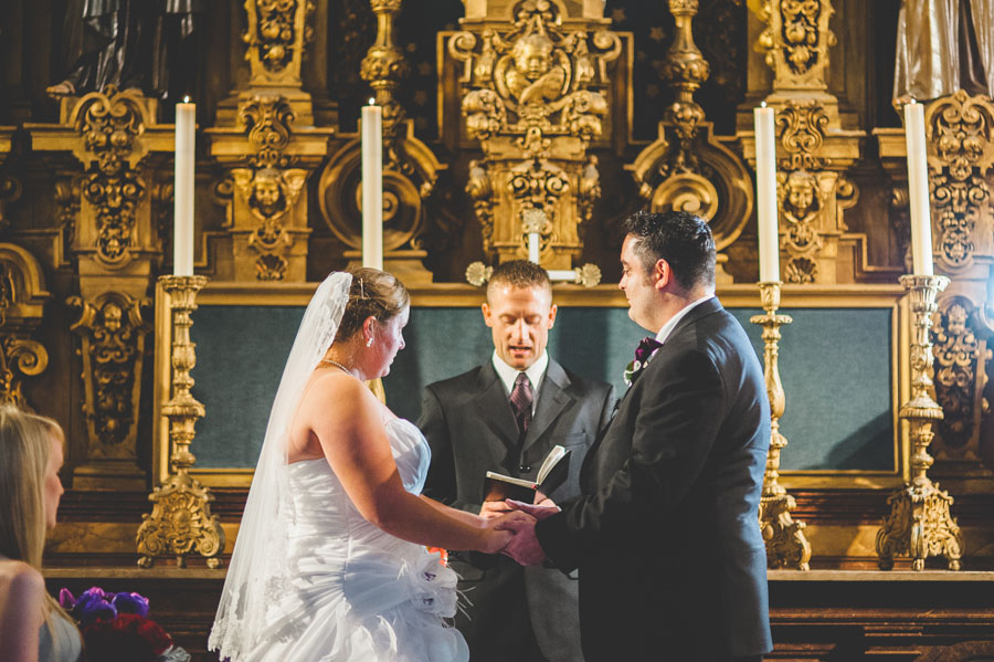 bride and groom get married in the saint francis chapel at balboa park