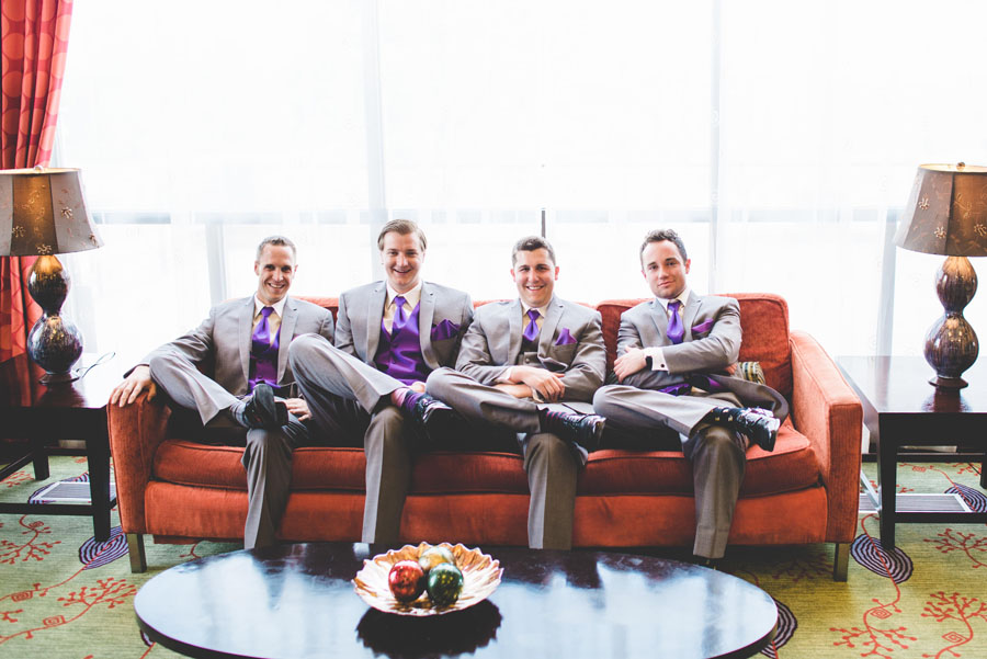 Groomsman pose on a couch in the Double Tree DTC