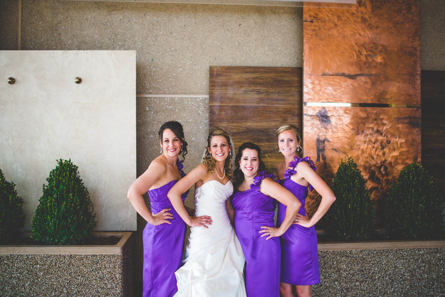 bridal party poses in front of the Double Tree Hotel denver tech center