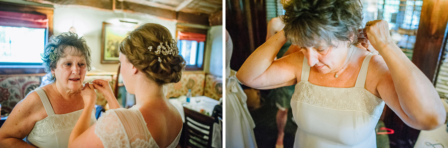 emotional bride helping mother put on necklace before wedding