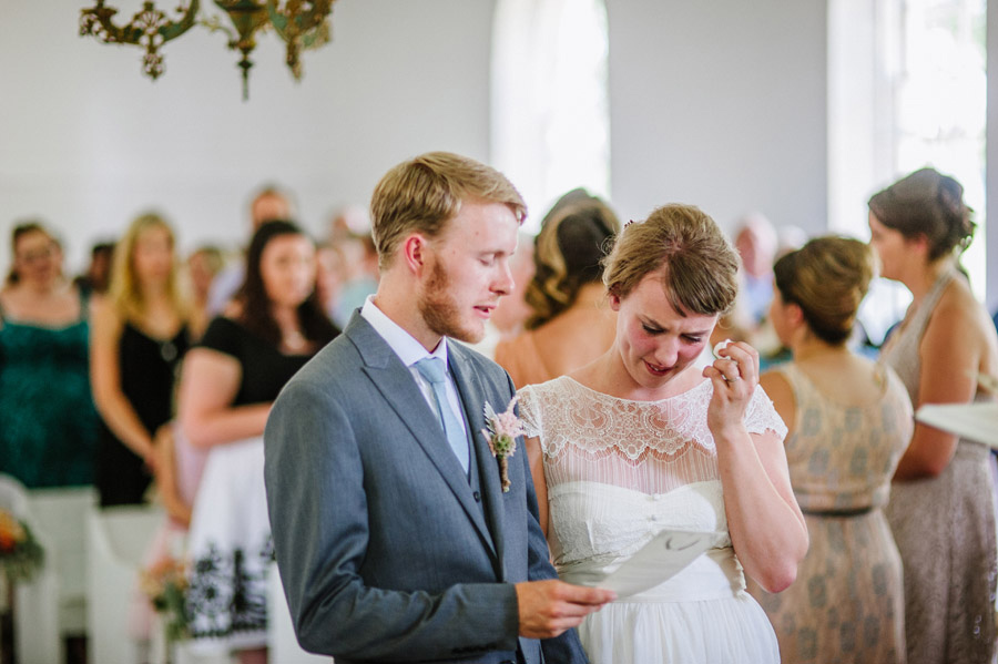 Bride and groom hold back tears during wedding in Longmont Colorado