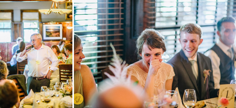 bride laughing during toasts at wedding
