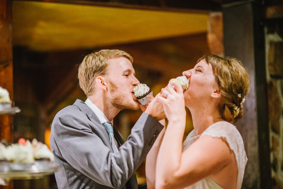 married couple share cup cakes in boulder co