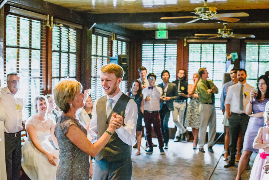 groom dances with his mother during wedding reception