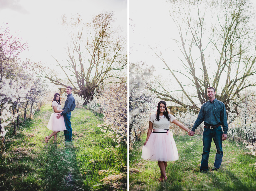 Engagement photo among apple blossoms in Longmont