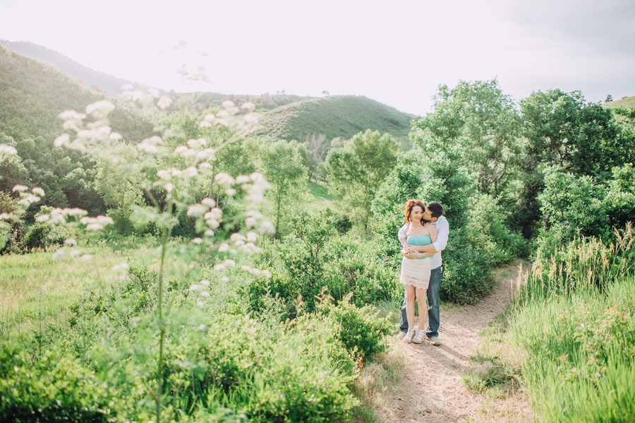 Couple standing on trail overlooking roxborough state park for anniverary portraits