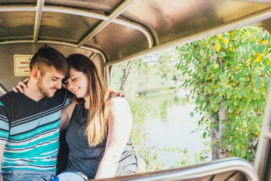 engagement photos on the train at lakeside amusement park