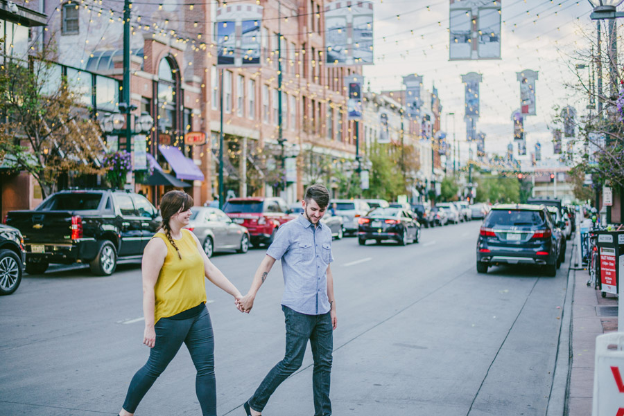 engagement photo under the lights of larimer square