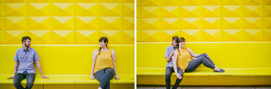 Engagement photos in downtown denver in front of the bright yellow wall on 14th street