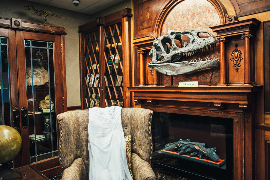 wedding dress near dinosaur skull at best western denver southwest