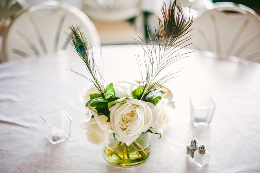 christies of genesee wedding center piece with peacock feather