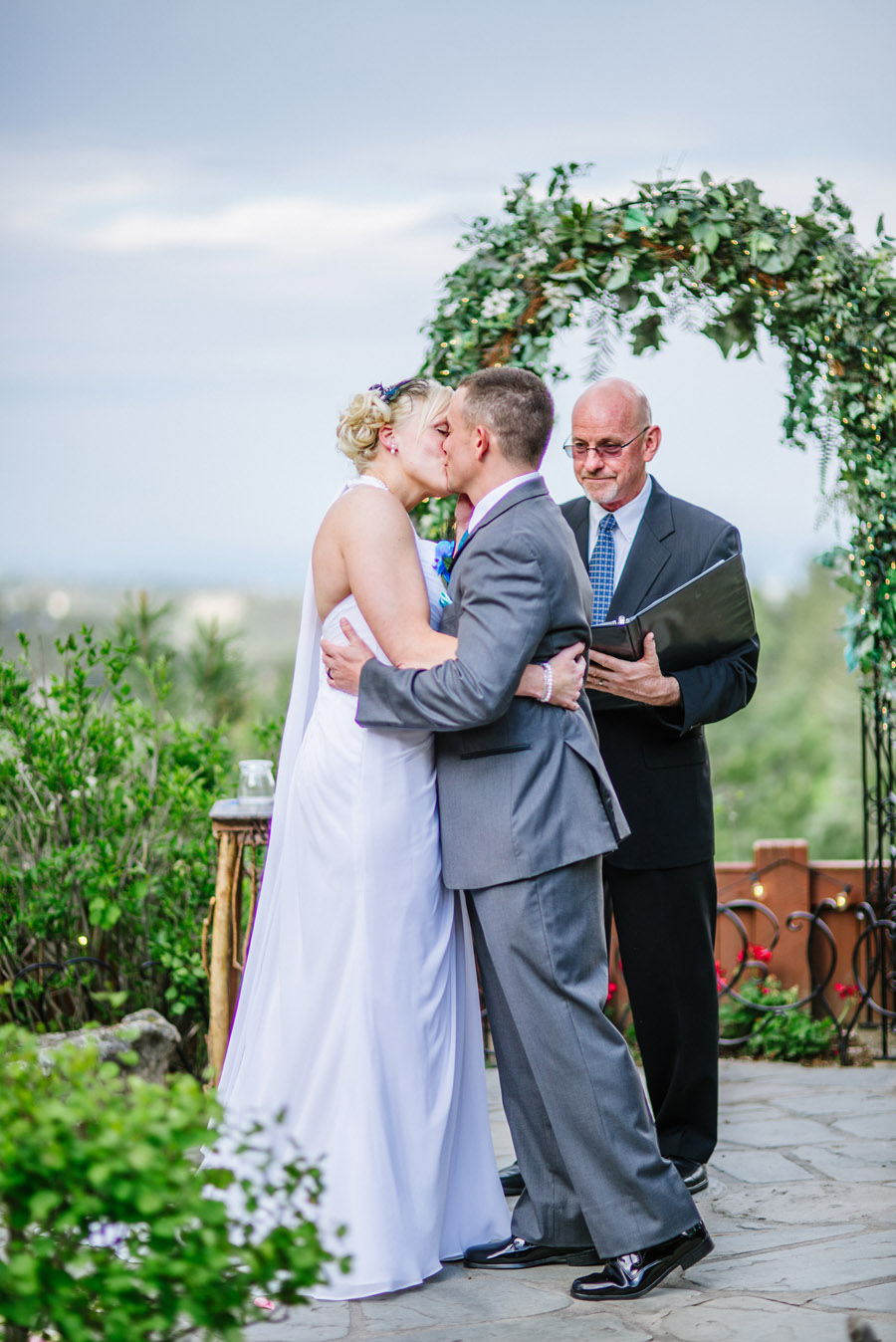 bride and groom share first kiss in genesee colorado