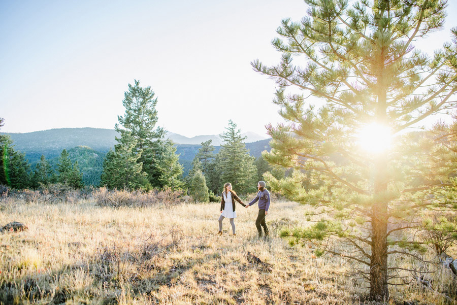 Gorgeous photo of a couple walking through the trees at hermit park