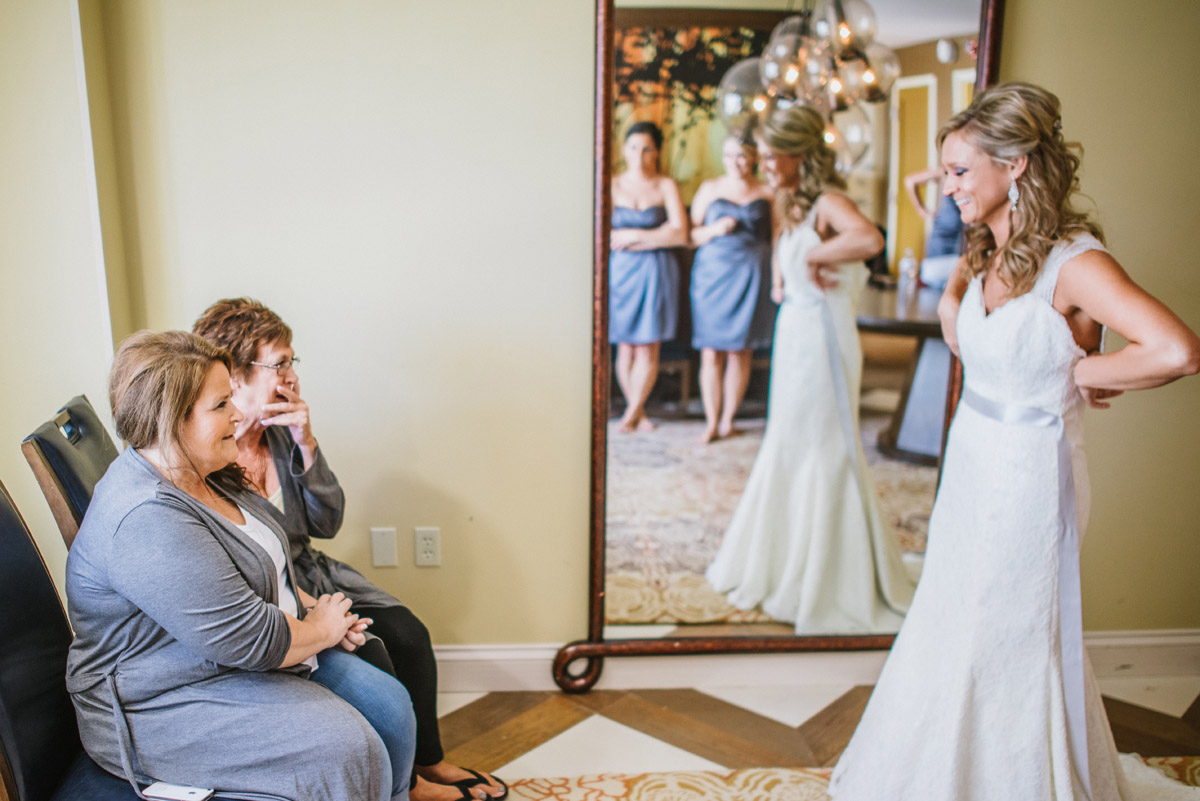 mom and mother in law react to seeing bride in wedding dress before wedding in omaha nebraska