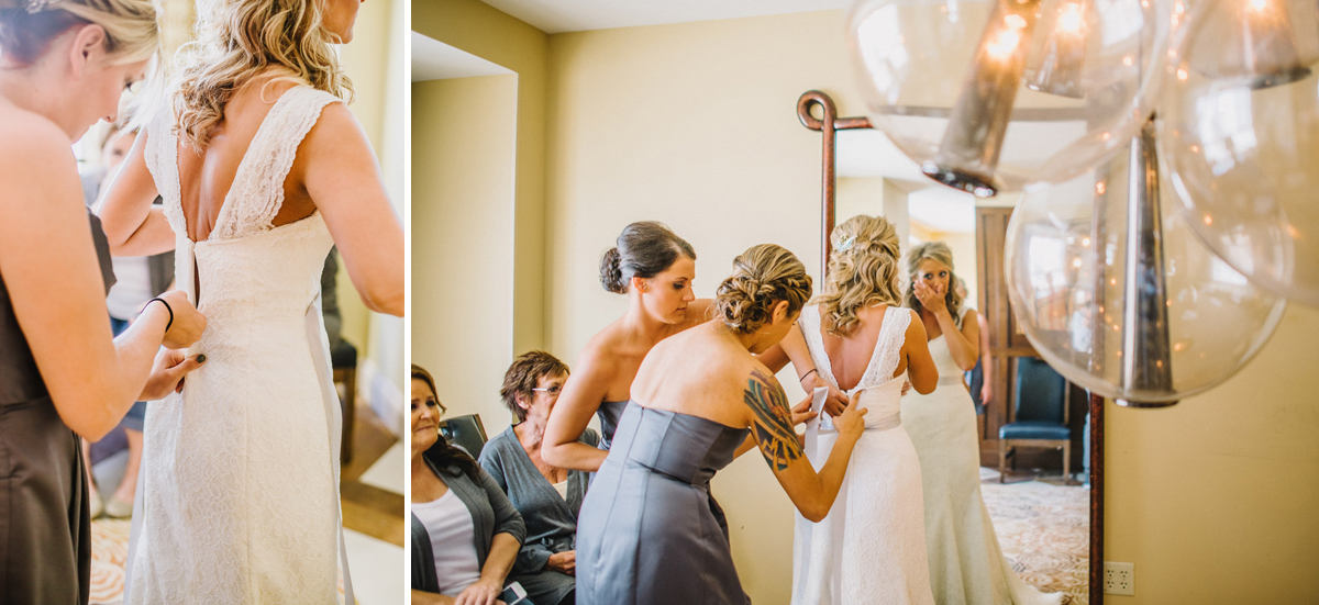 bridesmaids help tie brides dress