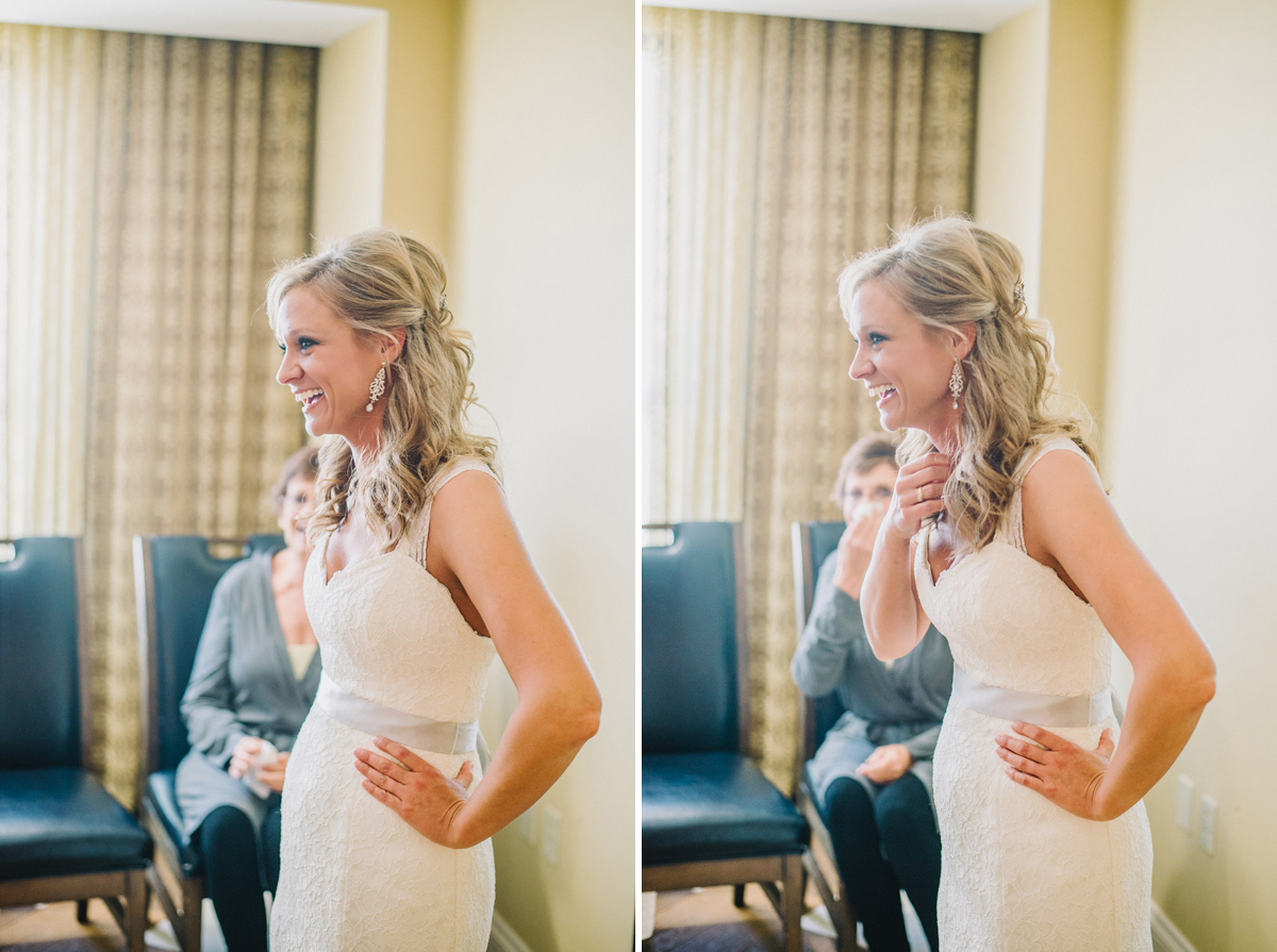 bride laughing after getting her dress on