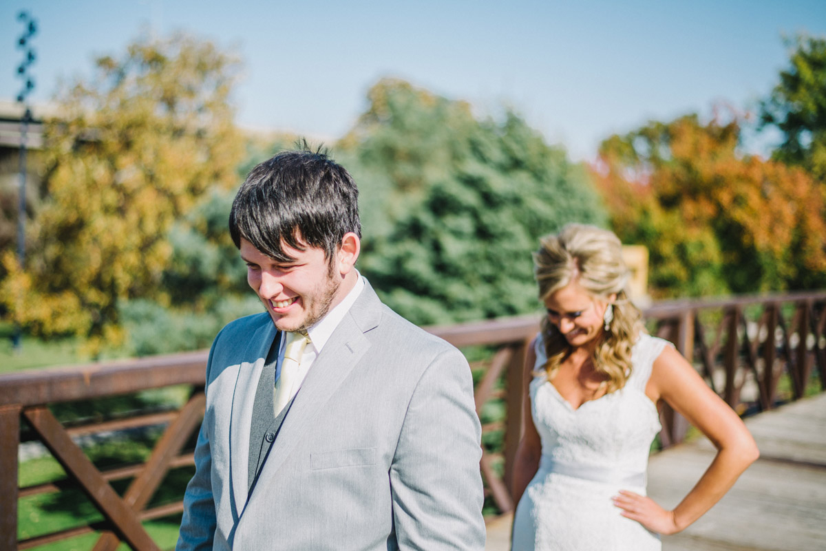 bride waiting for groom to turn around for first look