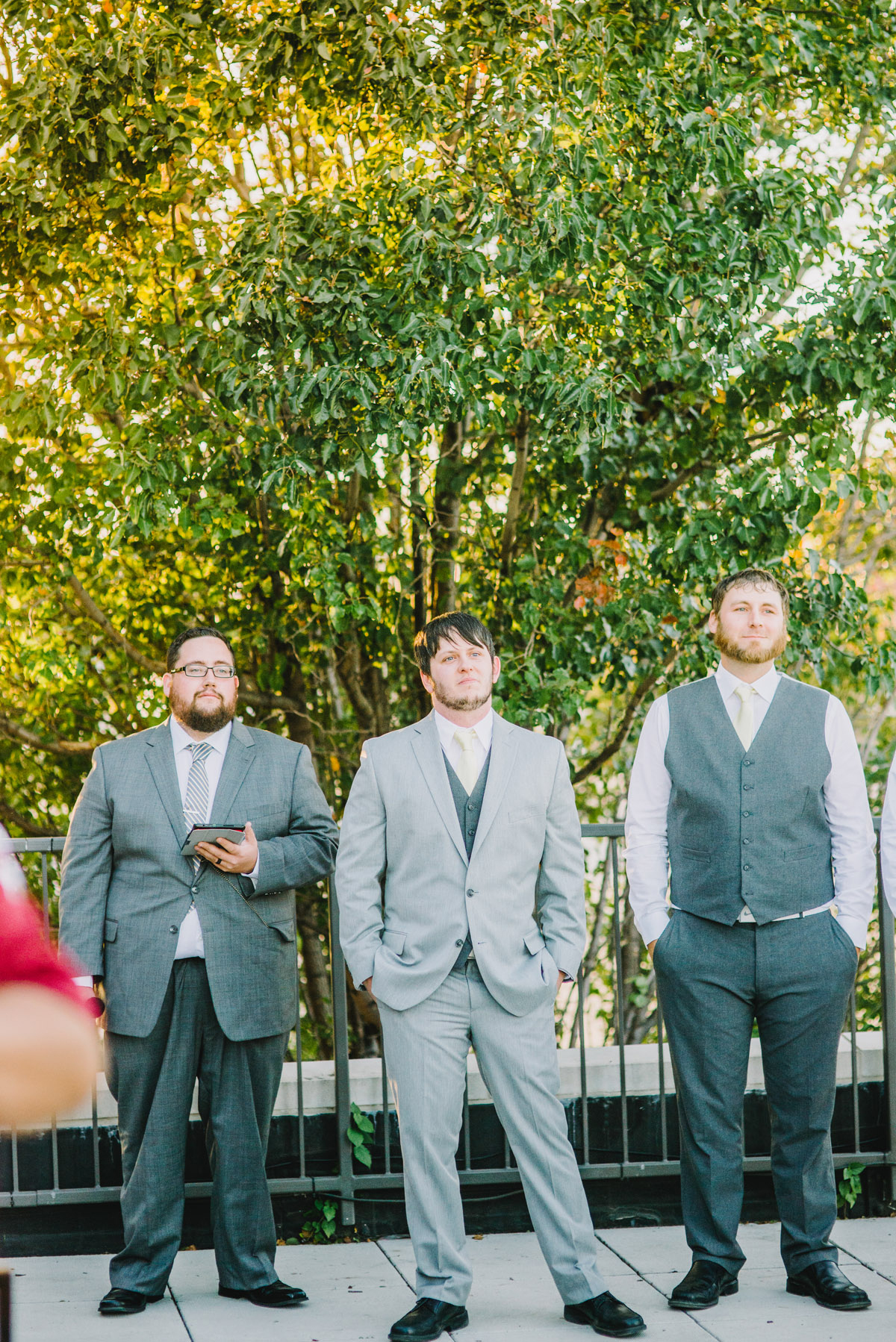 groom waiting for bride to walk down aisle at the old mattress factory in omaha