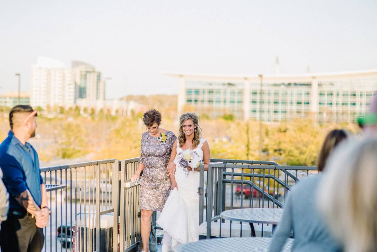 bride walking down aisle at the old mattress factory in omaha