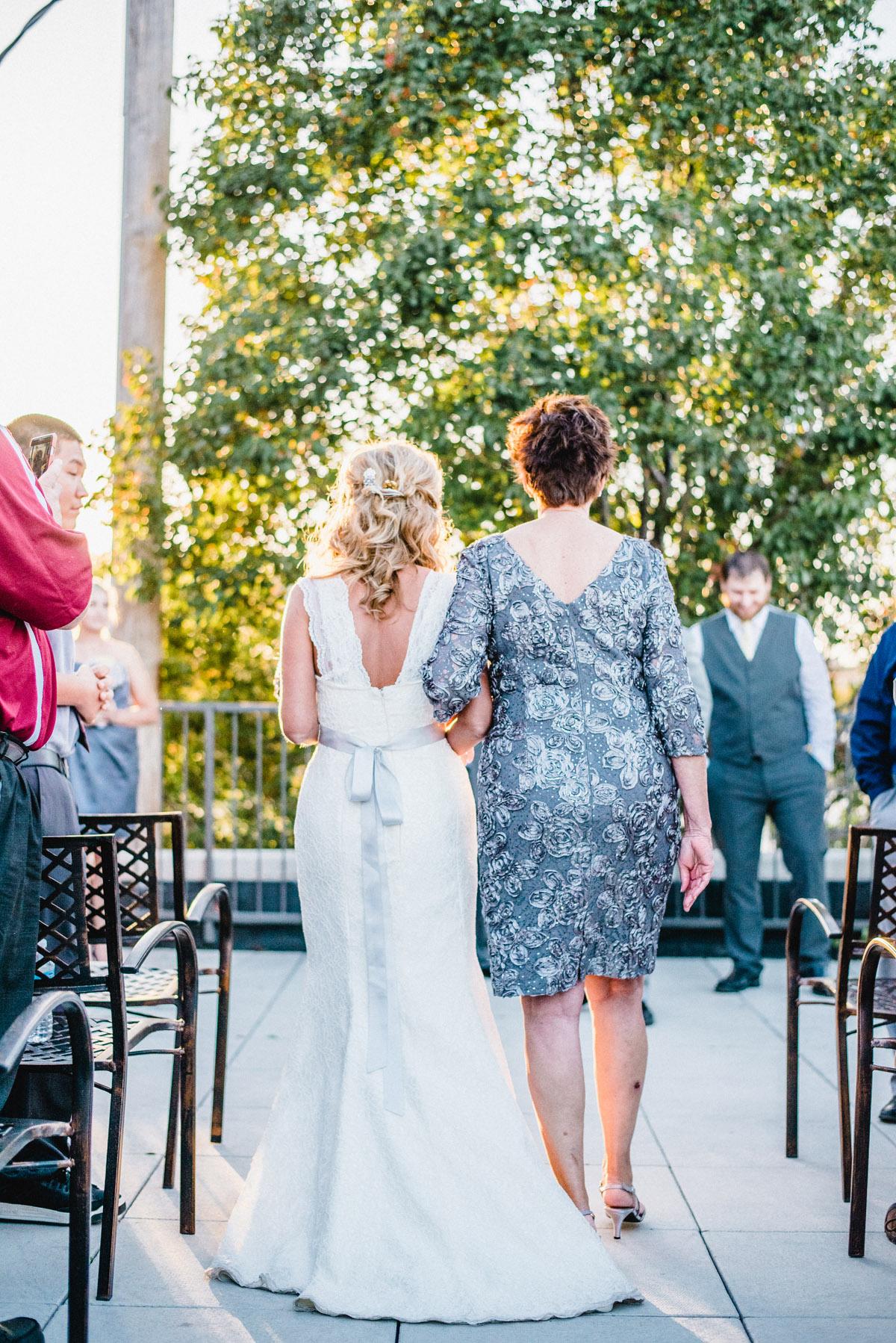 bride and mother walk down wedding aisle omaha ne