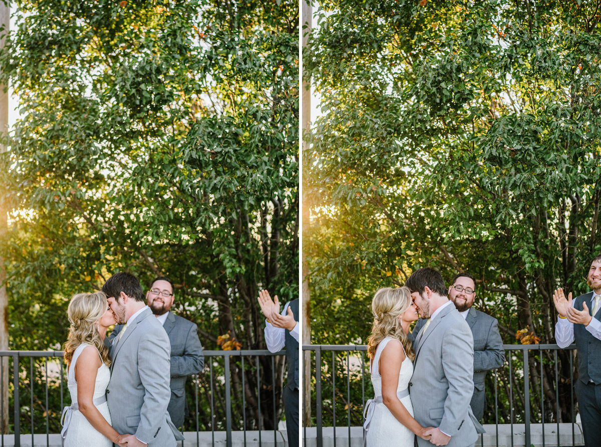 bride and groom share first kiss at the old mattress factory in omaha