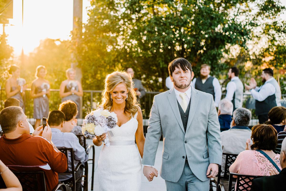 emotional bride and groom exiting wedding ceremony