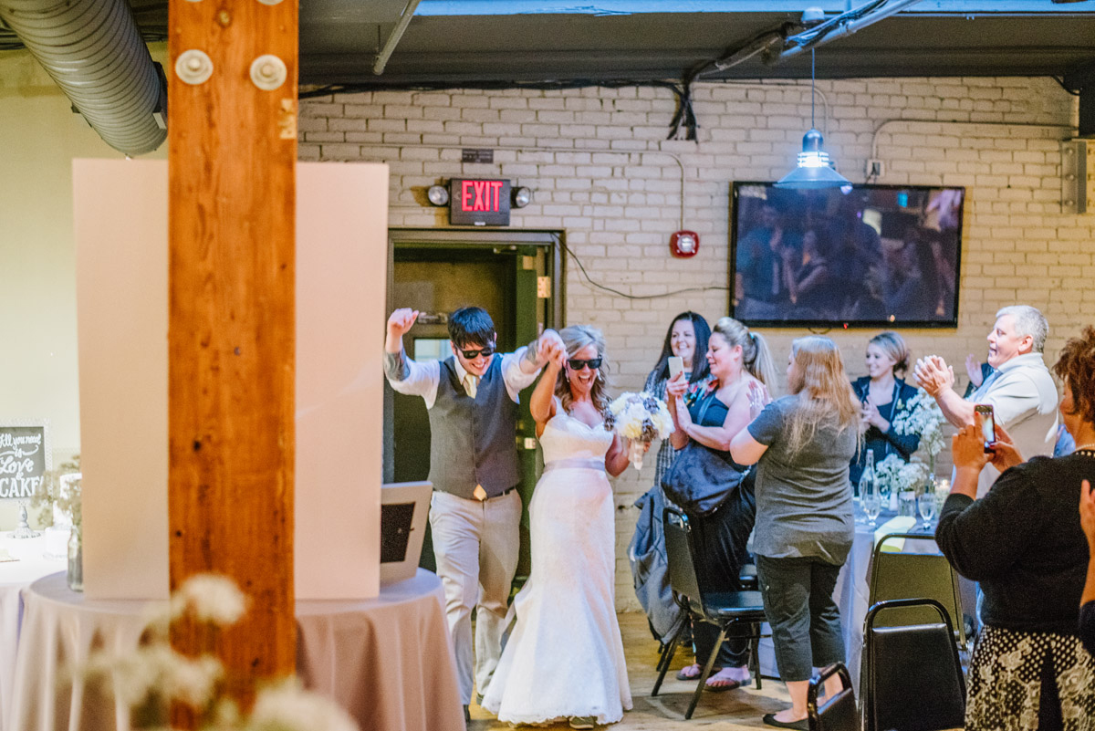 bride and groom make grand entrance to wedding reception