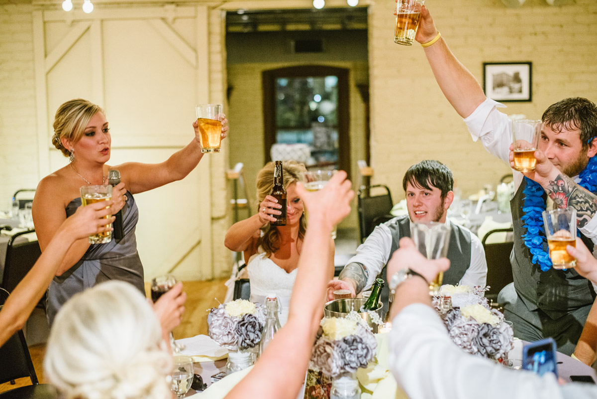 wedding party raising glasses during toast
