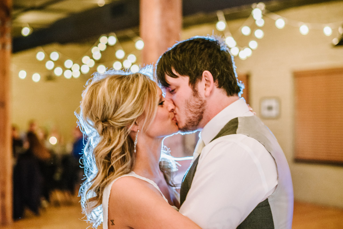 bride and groom kiss during first dance in omaha
