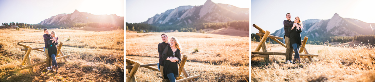 Engaged couple posing for photos in front of the Flatiron Mountains in Boulder