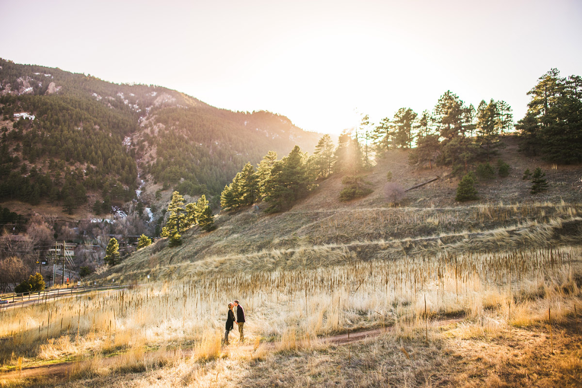 couple posing for engagement photos in boulder colorado at Settler's Park